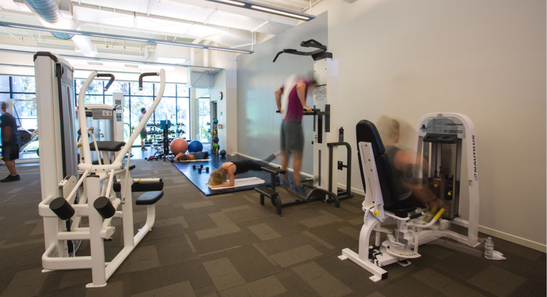 People working out inside the Fitness Center
